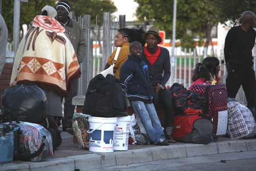 Entire families wait at the Joe Gqabi bus terminus in Philippi in order to catch a bus or taxi back to the Eastern Cape in order to spend the festive season at their traditional homesteads. Photo: Sandiso Phaliso/WCN