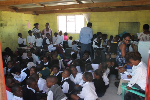 Over 100 children from Grades 1 - 5 are being informally taught in a church building in Zwelitsha as parents from the Khayelitsha informal settlements of Nkanini and Zwelitsha say they cannot find a place for their children in surrounding schools. Photo: Nombulelo Damba/WCN