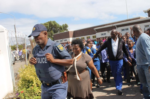 Principal of Qingqa Mntwana Primary school in Crossroads, Nosithembela Mahlathi was escorted from the premises by police yesterday (subs: Mon) after learners threw rocks at her, protesting against her return to her post. Photo: Nombulelo Damba/ WCN