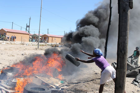 About 100 Crossroads residents burnt tyres in protest against Phase 2 of the Boystown Housing Project, accusing the ward councillor and steerign committee of fraudulently selling houses completed in Phase 1. Photo: Nombulelo Damba/WCN
