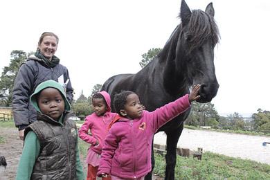 Horses help disabled children