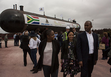 CEO of Royal Bafokeng Holdings, Albertinah Kekana (on left) speaks to Ipeleng Selele and Moses Tembe as engineers move one of the massive 74m-long 'bullets' in which Sunrise Energy is to store LP gas at the new import terminal currently being built at Saldanha. Photo: Steve Kretzmann/WCN