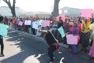 Over 200 parents from Samora Machel protested outside Khanya Primary in Mitchell's Plain yesterday after learning that land the WCED had apparently promised for a new school for their children had been purchased by Chippa United football club. Photo: Nombulelo Damba