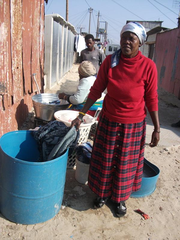 Residents splash through their own shacks
