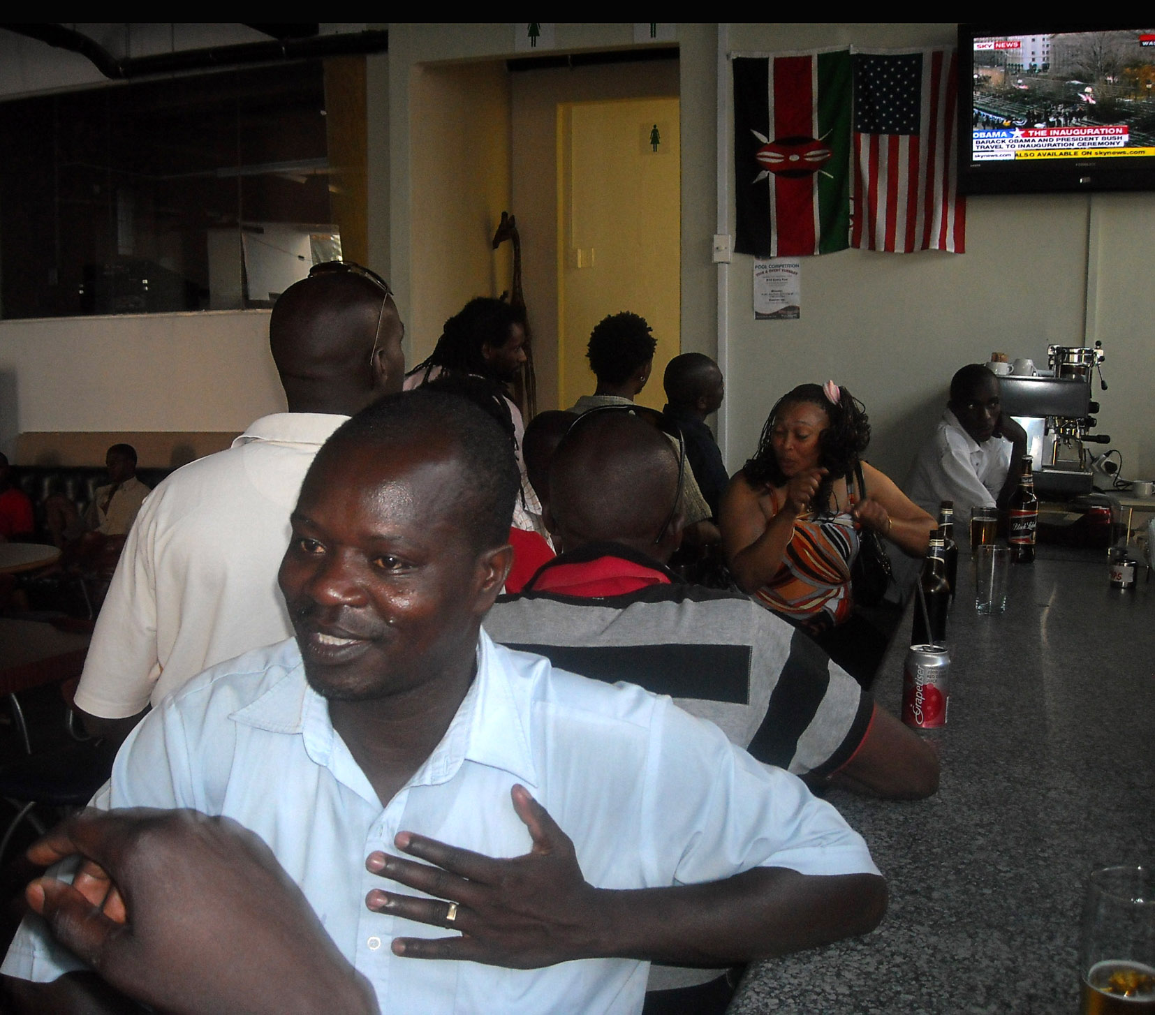 Kenyans living in Cape Town celebrated Obama's inauguration at a Kenyan-owned bar in Loop Street. Photo: Peter Luhanga/WCN
