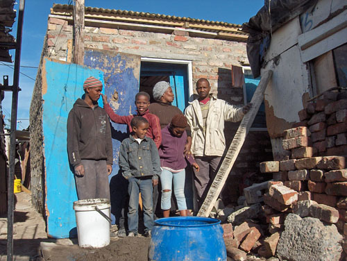 Showdown over squatter camp's brick house