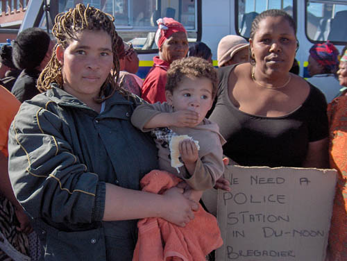 Geraldine Links and Wendy Jonasi were among about 300 women from Du Noon who marched several kilometres to the Milnerton police station to demonstrate against high levels of violent crime. Photo: Peter Luhanga/WCN