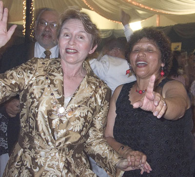 "Then Cape Town Executive Mayor Helen Zille dances with councillor Una Pick at the Mamre bi-centennial banquet in 2008. As she left the hall a youth called out ""Kyk vir djulle, daar gat Zille"" (Beware, there goes Zille), giving voice to the perception of clean, but iron-fisted governance. Photo: Steve Kretzmann/WCN"