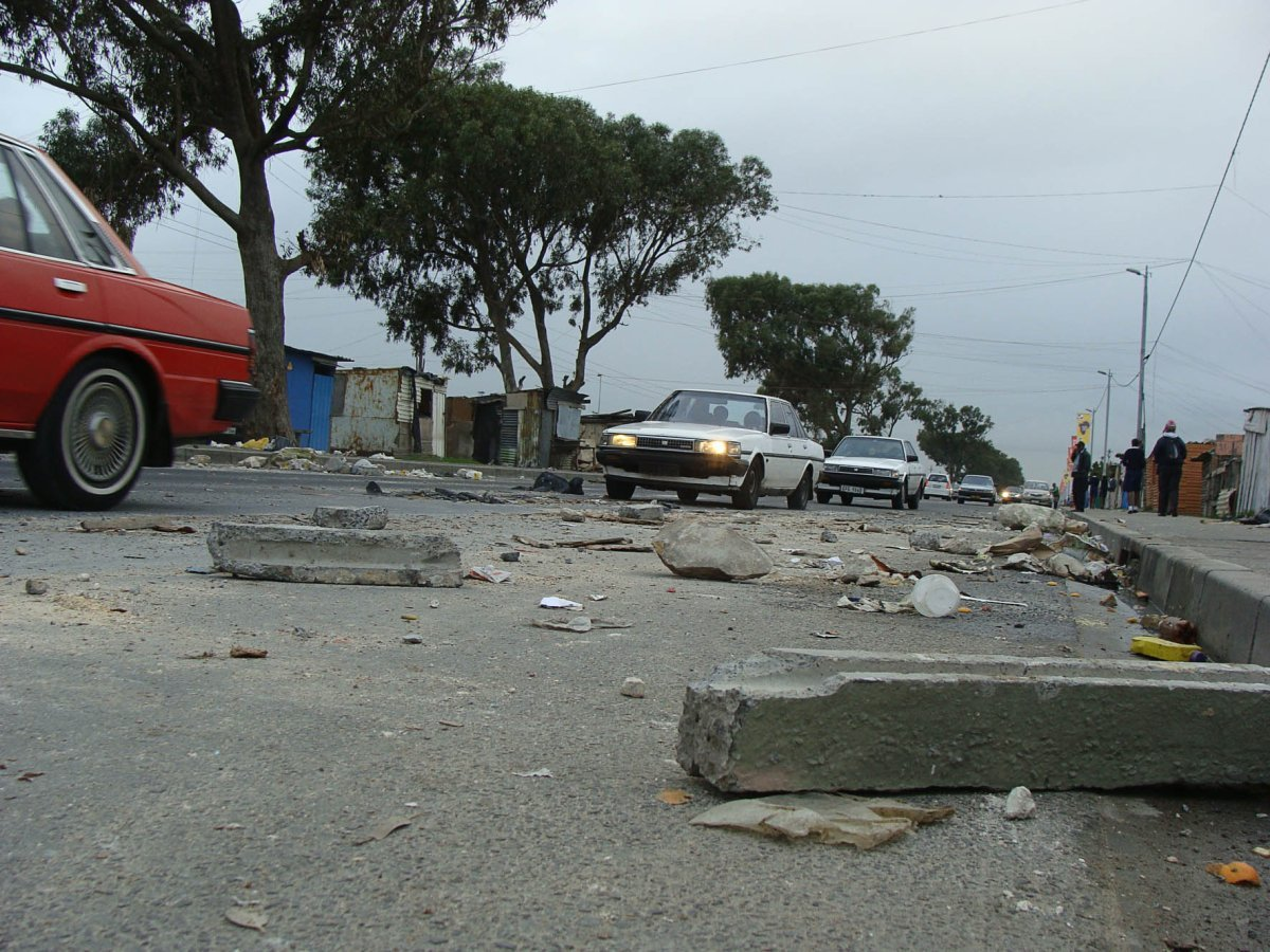 Debri from a blockade on Sheffield Road in Philippi remained an obstacle for motorists on Monday morning. Residents blockaded the road and stoned cars after a teenage girl was injured in a hit-and-run accident on Sunday night. Photo: Sandiso Phaliso/WCN