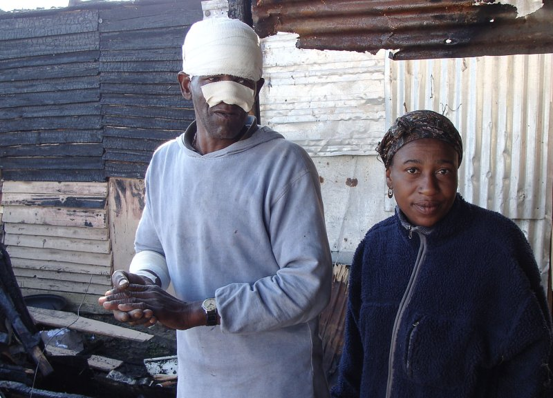 Woman saves pensioner from shack fire