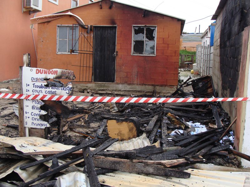 Sangoma burns down his own business