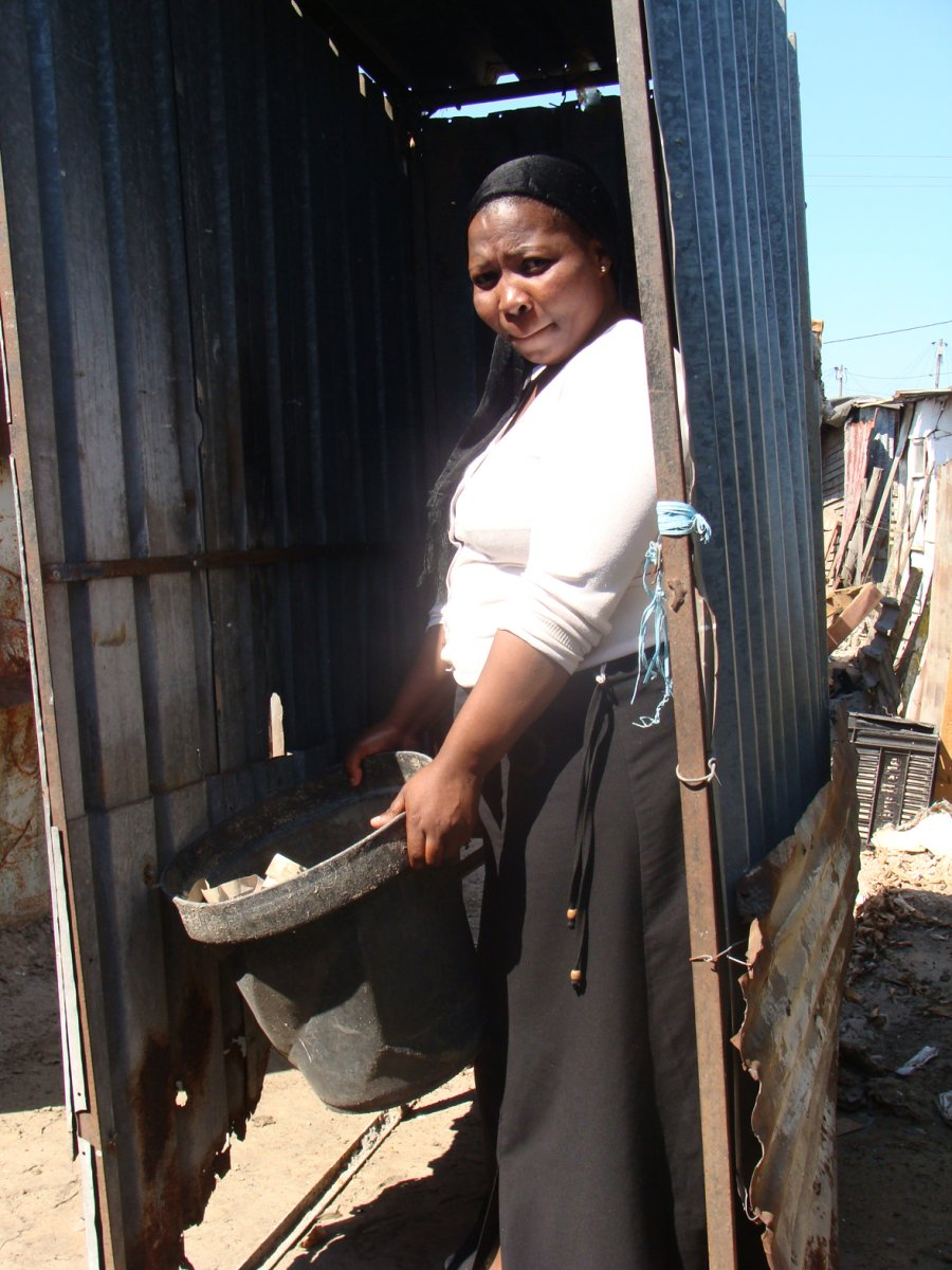 Pateka Katsikatsi, a resident of TR Section in Khayelitsha, Cape Town, says she is frustrated at still having to use a bucket toilet. Photo: Brenda Nkuna/WCN