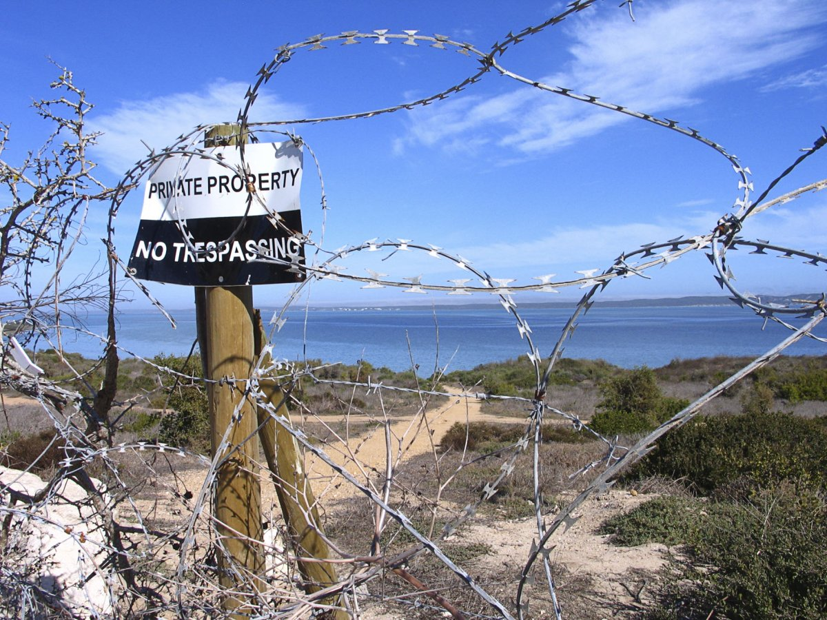 Shark Bay, a mecca for kiteboarders and windsurfers has been fenced off by the owners as they apply for permission to develop 109 residential units. The Langebaan community is strongly opposed to the developement. Photo: Steve Kretzmann/WCN