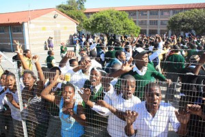 Protesting learners block road and stone bus