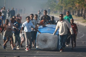 Anger over councilor's lack of action leads to fire on the streets