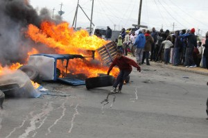 Protesting residents claim threats to burn down their shacks