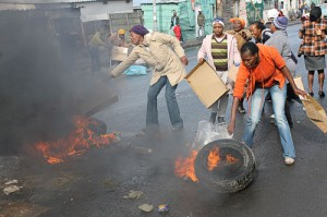 Burning tyres as accusation fly over housing project